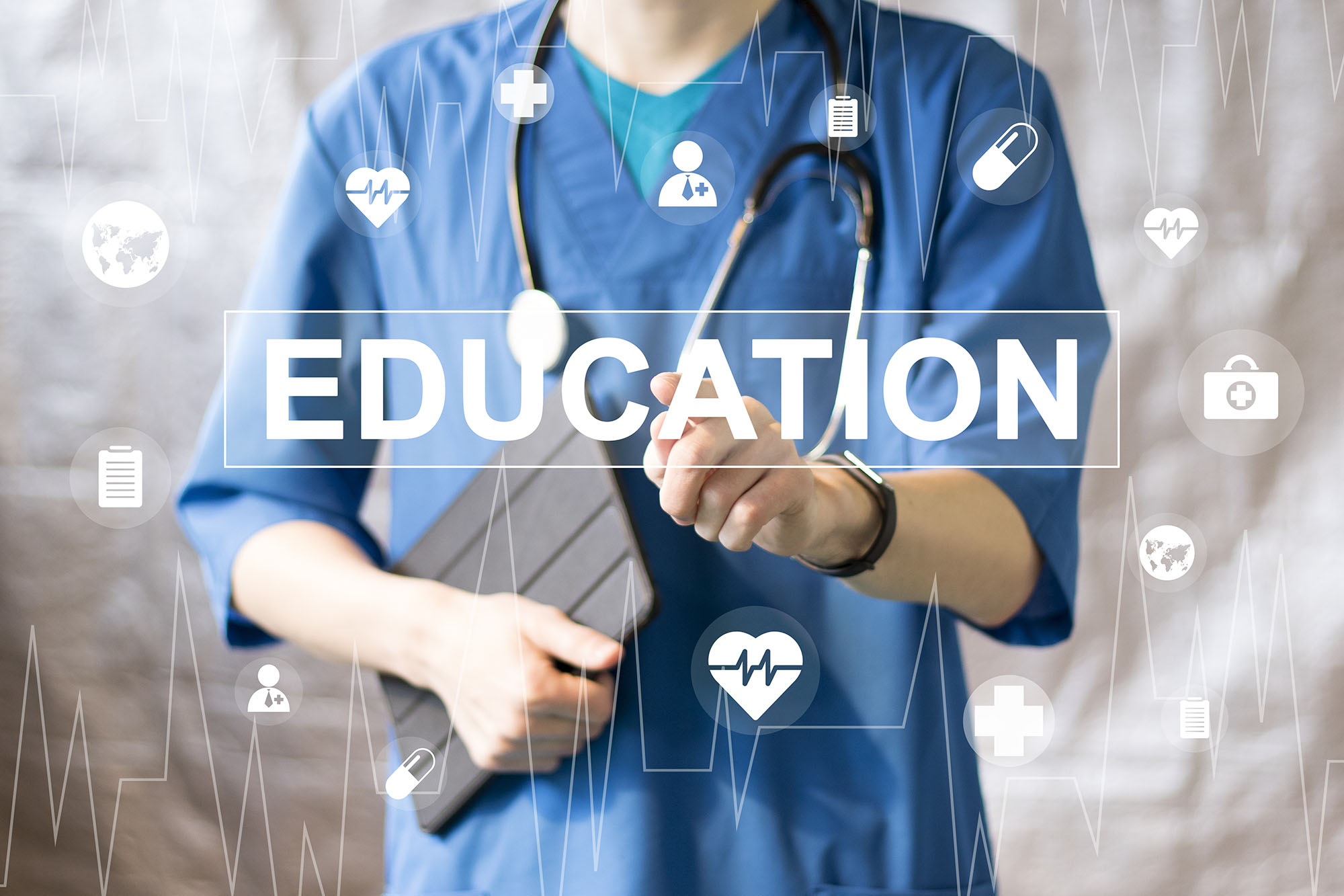 A health care professional wearing scrubs touches the word Education