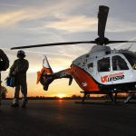 UT LIFESTAR aeromedical helicopter on helipad at sunrise